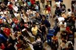 Passengers at George Bush Intercontinental airport crowd ter